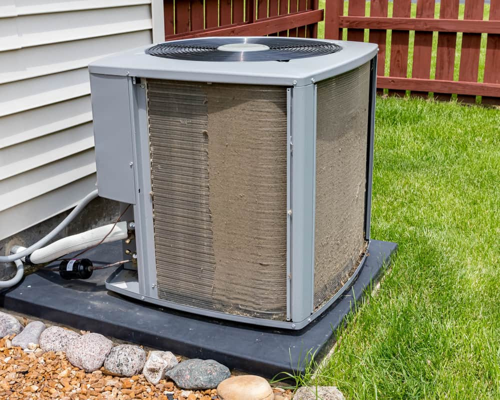 Dirty Air Conditioner Unit In Need of AC Cleaning Service.